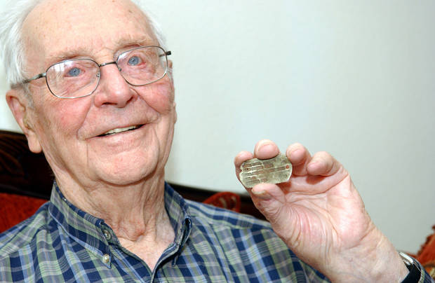 Alvin Krumrey, of Commerce, holds the dog tag that was returned to him after 70 years. Photos by GARY CROW, FOR THE OKLAHOMAN