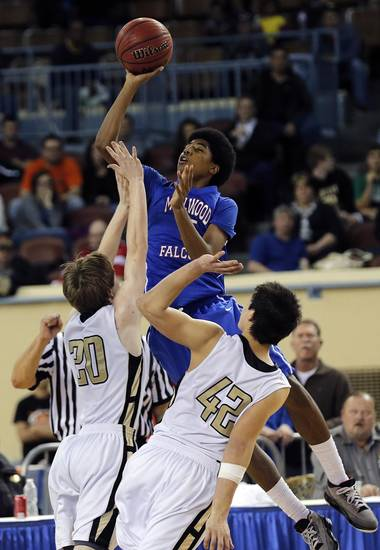 Millwood's Ashford Golden (5) drives to the basket against Okemah's Gus Klutts (20) and Dion Scott (42) during the state high school basketball tournament Class 3A boys championship game between Millwood High School and Okemah High School at the State Fair Arena on Saturday, March 9, 2013, in Oklahoma City, Okla. Photo by Chris Landsberger, The Oklahoman