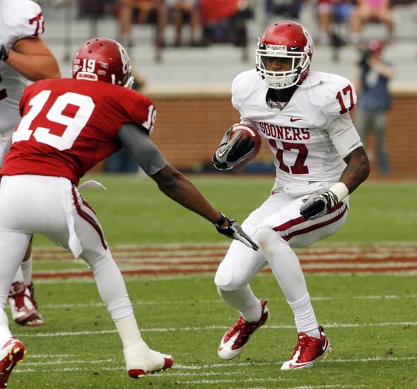 Trey Metoyer (17) comes up against Joe Powell (19) after a reception during the University of Oklahoma (OU) football team's annual Red and White Game at Gaylord Family/Oklahoma Memorial Stadium on Saturday, April 14, 2012, in Norman, Okla.  Photo by Steve Sisney, The Oklahoman