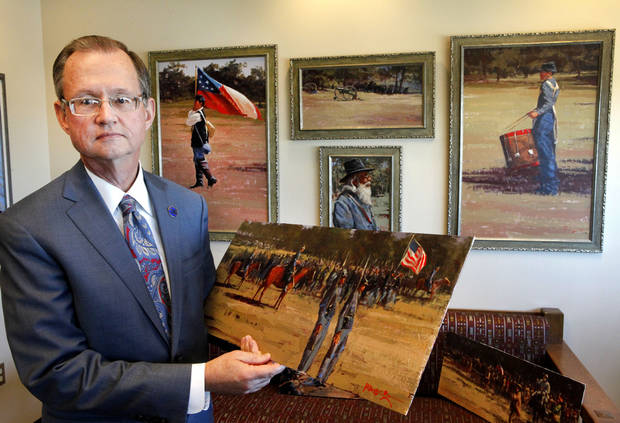 Bob Blackburn, executive director of the Oklahoma Historical Society, holds artwork by Mike Larsen of the Battle of Honey Springs. Photo by David McDaniel, The Oklahoman