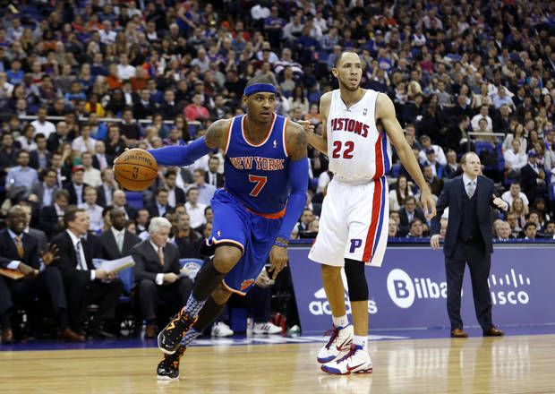New York Knicks forward Carmelo Anthony, left, takes the ball past Detroit Pistons forward Tayshaun Prince during their NBA basketball game at the 02 arena in London, Thursday, Jan. 17, 2013.  (AP Photo/Matt Dunham)