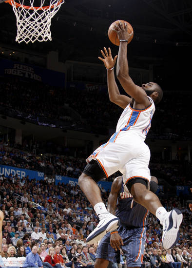 Oklahoma City's James Harden (13) goes to the basket in front of Charlotte's Stephen Jackson (1) during the NBA basketball game between the Oklahoma City Thunder and the Charlotte Bobcats at the Oklahoma City Arena, Friday, March 18, 2011. Photo by Bryan Terry, The Oklahoman