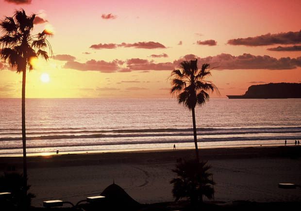 In this San Diego Convention & Visitors Bureau photo, the sun sets over Coronado Beach in San Diego. (AP PHOTO)