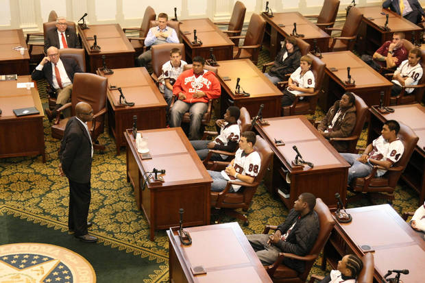 Former Oklahoma running back Joe Washington speaks to members of the Capitol Hill football team on Thursday, Oct. 27, 2011, at the state capitol in Oklahoma City. PHOTO PROVIDED KOD