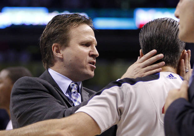 Oklahoma City coach Scott Brooks grabs official Ken Mauer during Game 4 of the Western Conference Finals between the Oklahoma City Thunder and the San Antonio Spurs in the NBA playoffs at the Chesapeake Energy Arena in Oklahoma City, Saturday, June 2, 2012. Oklahoma CIty won 109-103. Photo by Bryan Terry, The Oklahoman