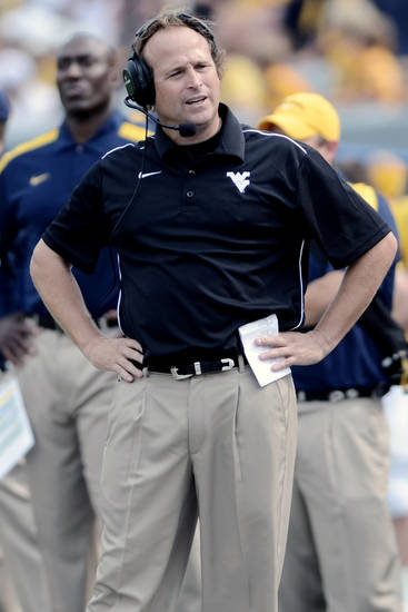 West Virginia coach Dana Holgorsen looks on against Marshall during the second quarter of a NCAA football game Sunday, Sept. 4, 2011 in Morgantown, W.Va. (AP Photo/Jeff Gentner)
