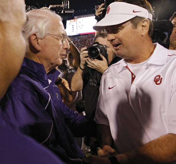 Bill Snyder and Bob Stoops meet at midfield after the Wildcats' 24-19 win over Oklahoma during the college football game between the University of Oklahoma Sooners (OU) and the Kansas State University Wildcats (KSU) at the Gaylord Family-Memorial Stadium on Saturday, Sept. 22, 2012, in Norman, Okla. Photo by Chris Landsberger, The Oklahoman