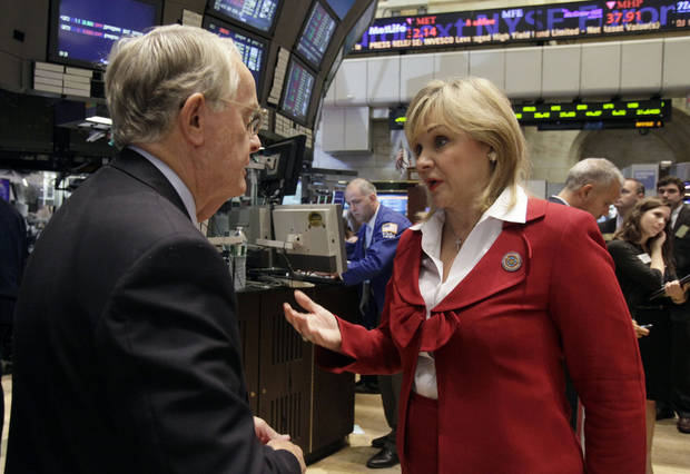 Gov. Mary Fallin on the trading floor after ringing the opening bell of the New York Stock Exchange in August 2011. Fallin was in Washington, D.C., and New York for a State Chamber fly-in that cost taxpayers $11,850.AP Photo