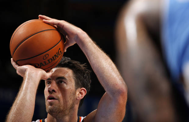 Oklahoma City's Nick Collison (4) takes a free-throw during the NBA preseason basketball game between the Oklahoma City Thunder and the Denver Nuggets at the Chesapeake Energy Arena, Sunday, Oct. 21, 2012. Photo by Garett Fisbeck, The Oklahoman