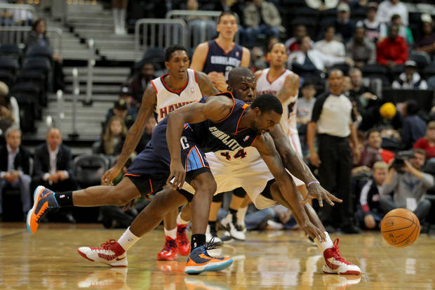 Charlotte Bobcats shooting guard Ben Gordon (8) fights for the ball with Atlanta Hawks power forward Ivan Johnson (44) in the first half of an NBA basketball game on Thursday, Dec. 13, 2012, in Atlanta. (AP Photo/Todd Kirkland)