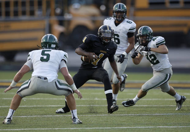 Cedric Fair (1) runs the ball during a high school football game between Midwest City and Norman North in Midwest City, Friday, Sept. 21, 2012.  Photo by Garett Fisbeck, The Oklahoman