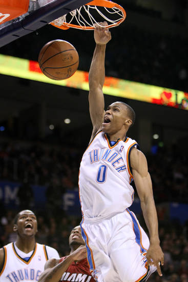 OKLAHOMA CITY THUNDER / MIAMI HEAT / NBA BASKETBALL / SLAM DUNK: Oklahoma City's Russell Westbrook goes in for a slam over Miami's Mario Chalmers during the Thunder - Heat game January 18, 2009 in Oklahoma City.    BY HUGH SCOTT, THE OKLAHOMAN ORG XMIT: KOD