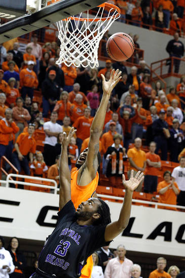 Oklahoma State's Michael Cobbins (20) shoots over Central Arkansas' Oliver Wells (23) during the men's college basketball game between Oklahoma State University and Central Arkansas at Gallagher-Iba Arena in Stillwater, Okla., Sunday,Dec. 16, 2012. Photo by Sarah Phipps, The Oklahoman