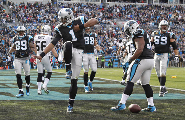 Carolina Panthers' Cam Newton (1) celebrates his touchdown run against the Oakland Raiders during the first half of an NFL football game in Charlotte, N.C., Sunday, Dec. 23, 2012. (AP Photo/Bob Leverone)