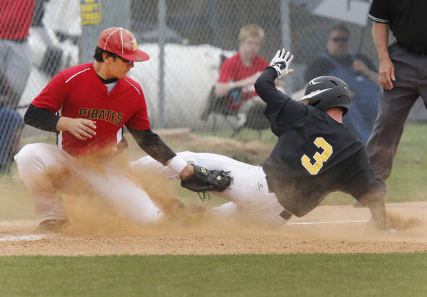 Alva's Cody Jones beats Dale's Xavier Lanham's tag as he steals 3rd base  during the Class 2A state tournament at Palmer Field in Oklahoma City , Thursday May 9, 2013. Photo By Steve Gooch, The Oklahoman