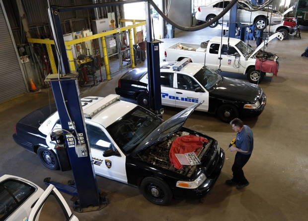 Norman Fleet Manager Mike White shows some of the vehicles inside the city garage waiting for maintenance work. PHOTO BY STEVE SISNEY, THE OKLAHOMAN
