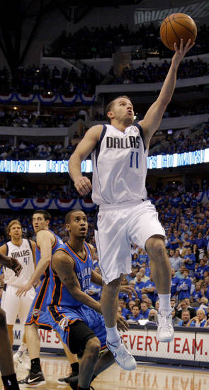 Jose Juan Barea (11) of Dallas goes past Oklahoma City's Eric Maynor (6) during game 5 of the Western Conference Finals in the NBA basketball playoffs between the Dallas Mavericks and the Oklahoma City Thunder at American Airlines Center in Dallas, Wednesday, May 25, 2011. Photo by Bryan Terry, The Oklahoman