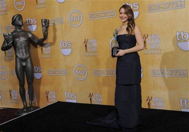 Actress Jennifer Lawrence poses backstage with the award for best female actor in a leading role at the 19th Annual Screen Actors Guild Awards at the Shrine Auditorium in Los Angeles on Sunday Jan. 27, 2013. (Photo by Chris Pizzello/Invision/AP)