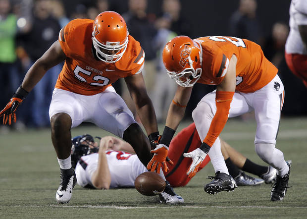 Oklahoma State's Ryan Simmons (52) and Zack Craig (23) chase down a block punt that Craig returned for a touchdown during the college football game between the Oklahoma State University Cowboys (OSU) and Texas Tech University Red Raiders (TTU) at Boone Pickens Stadium on Saturday, Nov. 17, 2012, in Stillwater, Okla.   Photo by Chris Landsberger, The Oklahoman