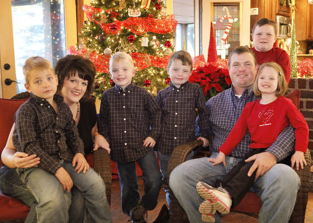 Rick and Jennifer Payne�s quadruplets turned 5 this month. Shown from left are Preston, 5, Jennifer, Carson, 5, Griffin, 5, Rick, Parker, 8, and Claire, 5. Photo by David McDaniel, The Oklahoman