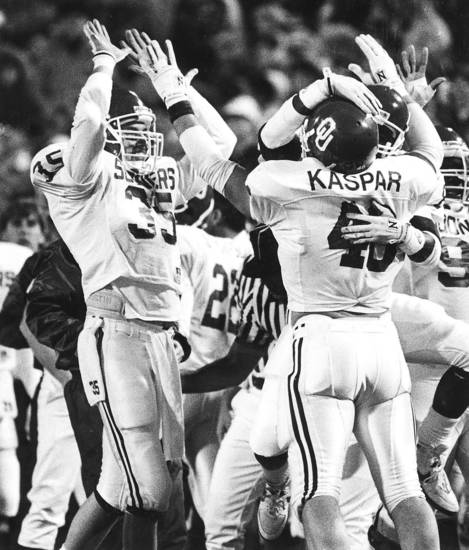 The OU defense celebrates after stopping OSU's last drive in the 1988 Bedlam college football game. Staff photo by Paul Hellstern