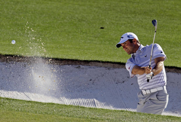 Trevor Immelman, of South Africa, hits out of a bunker on the 17th hole during the second round of the Masters golf tournament Friday, April 6, 2012, in Augusta, Ga. (AP Photo/Charlie Riedel)