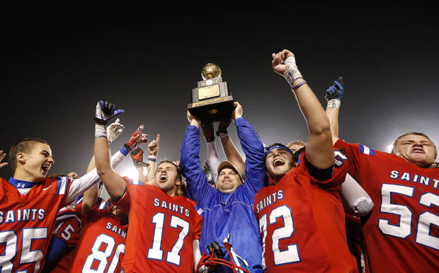 OCS celebrates the Class 2A high school football championships over Davis at Boone Pickens Stadium in Stillwater, Okla.,  Saturday,Dec. 8, 2012. Photo by Sarah Phipps, The Oklahoman