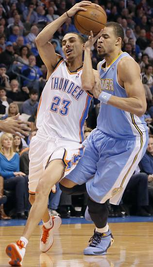 Oklahoma City&#039;s Kevin Martin (23) drives past Denver&#039;s JaVale McGee (34) during the NBA basketball game between the Oklahoma City Thunder and the Denver Nuggets at the Chesapeake Energy Arena on Wednesday, Jan. 16, 2013, in Oklahoma City, Okla.  Photo by Chris Landsberger, The Oklahoman
