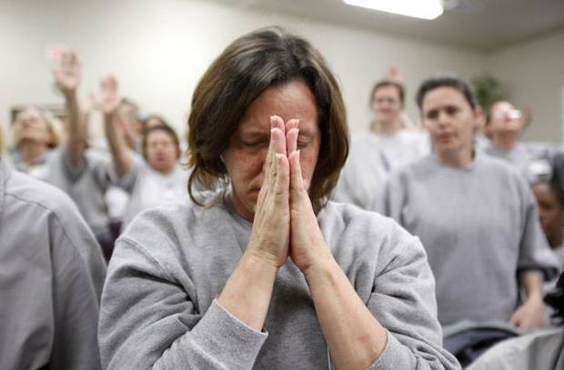 CHURCH / PRISON: An inmate prays during the Shadows of the Cross service at chapel at Eddie  W. Warrior Correctional Center, Sunday, March 28, 2010, in Taft, Okla. Photo by Sarah Phipps, The Oklahoman  ORG XMIT: KOD