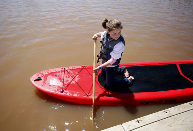 Reagan Cook, 8, of Midwest City, Okla.,  tries out a paddle boat during the Paddle Now! Youth Experience on the Oklahoma River,  Saturday, April 21, 2012. Photo by Sarah Phipps, The Oklahoman.