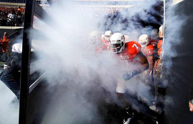 Oklahoma State's Michael Harrison (7) leads the Cowboys onto the field before the start of the college football game between the Oklahoma State University Cowboys (OSU) and the Baylor University Bears at Boone Pickens Stadium in Stillwater, Okla., Saturday, Nov. 6, 2010. Photo by Chris Landsberger, The Oklahoman