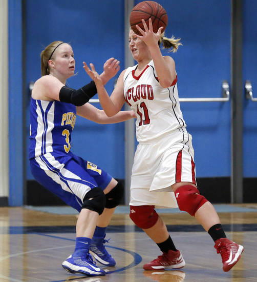 Piedmont's Alex Hall (31) defends on McLoud's Erica Hostetter (11) during a basketball tournament at the Kingfisher High School gym on Thursday, Jan. 24, 2013, in Kingfisher, Okla.  Photo by Chris Landsberger, The Oklahoman