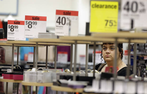 Kayla Harris, of Mohave Valley, Ariz., browses through a display of jewelry at a Sears store Friday, Nov. 23, 2012, in Henderson, Nev. Black Friday, the day when retailers traditionally turn a profit for the year, got a jump start this year as many stores opened just as families were finishing up Thanksgiving dinner. (AP Photo/Julie Jacobson)