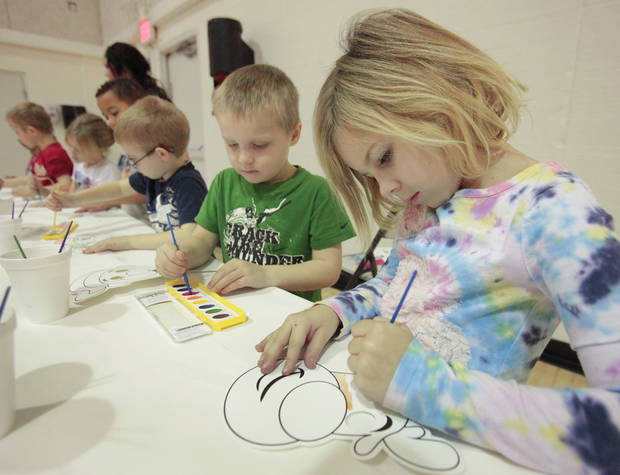 Bry Lie, 6, paints a reindeer mask during the Before and After School Care program at the YMCA in Edmond, Thursday, December 22 , 2011.   Photo by David McDaniel, The Oklahoman