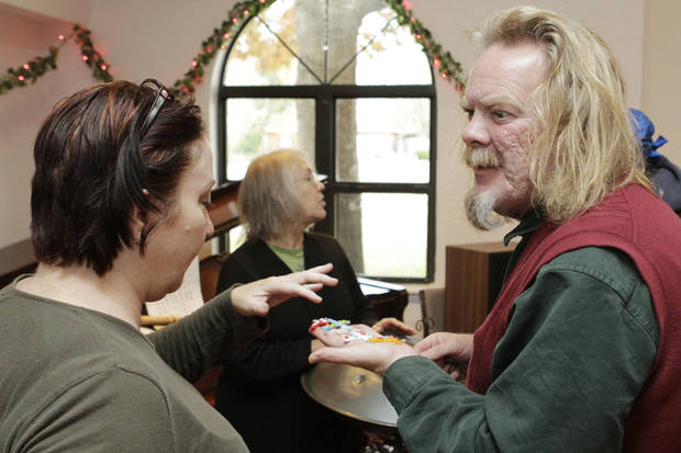 Ed Kearns shows some of his glass bead jewelry to Catherine Kerley during the Winter Thyme Arts Market at the West Wind Unitarian Universalist Congregation Church in Norman, OK, Saturday, Nov. 26, 2011. By Paul Hellstern, The Oklahoman