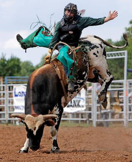 Cody Tyler White, of Choctaw, Okla., competes in bull riding during the final round of the International Finals Youth Rodeo in Shawnee, Okla., Saturday, July 18, 2009. By Nate Billings, The Oklahoman