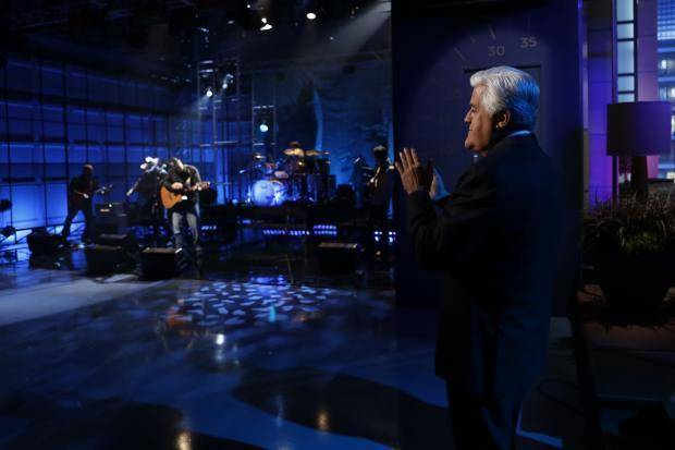 "Jay Leno, right, watches as musical guest Garth Brooks performs during Leno's final episode of ""The Tonight Show,"" Thursday, Feb. 6, 2014, in Burbank, Calif.  (NBC photo)"