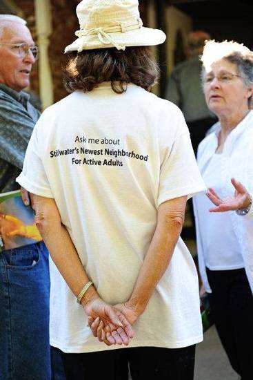 An Oakcreek member promotes the community at its recent groundbreaking. PHOTO PROVIDED