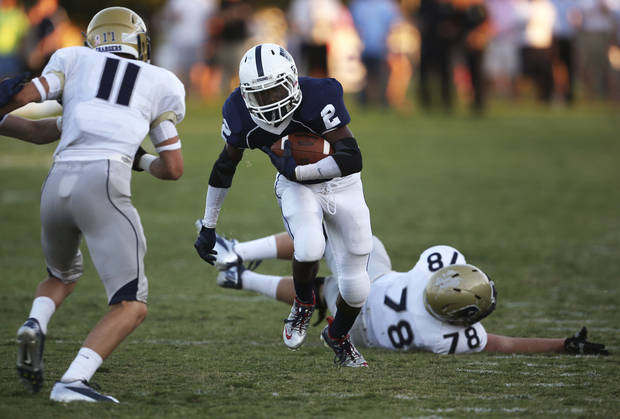 Casady's Delwin Richard (2) carries the ball during a game between Casady and Heritage Hall at Casady High School in The Village, Okla., Thursday, Aug. 30, 2012.  Photo by Garett Fisbeck, The Oklahoman