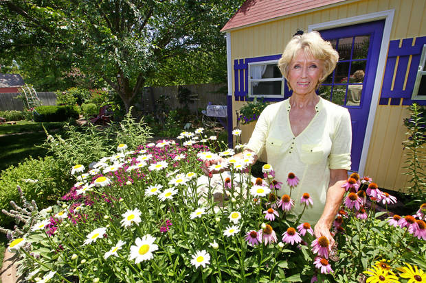 Master Gardener Anne Griswold in her back yard at her home in Edmond.  <strong>David McDaniel - The Oklahoman</strong>