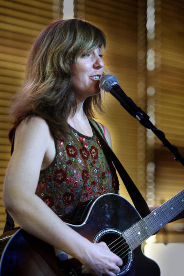 Susan Herndon plays in 2009 during the Norman Music Festival on Main Street in Norman. Photo by Steve Sisney, The Oklahoman Archives