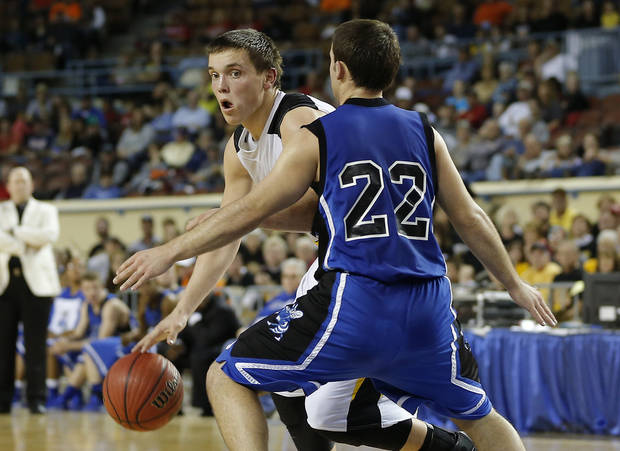 Arnett's Tyler Tune goes around Coyle's Ryan Weathers during the Class B boys state championship game between Coyle and Arnett in the State Fair Arena at State Fair Park in Oklahoma City, Saturday, March 2, 2013. Photo by Bryan Terry, The Oklahoman
