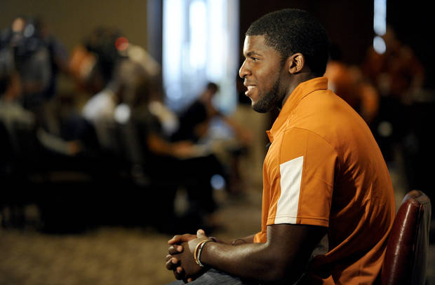 Texas linebacker Emmanuel Acho answers questions during NCAA college football Big 12 Media Days, Monday, July 25, 2011, in Dallas. (AP Photo/Matt Strasen)