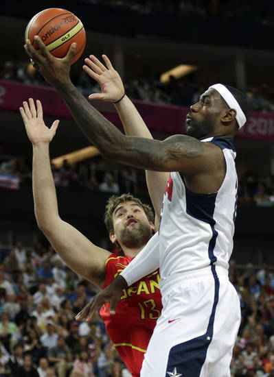 United States' LeBron James shoots over Spain's Marc Gasol during the men's gold medal basketball game at the 2012 Summer Olympics, Sunday, Aug. 12, 2012, in London. (AP Photo/Charles Krupa)