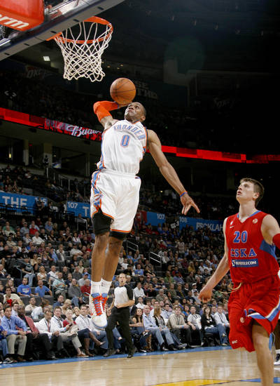 Oklahoma City's Russell Westbrook (0) goes to the basket in front of CSKA Moscow's Andrey Vorontsevich (20)during the preseason NBA basketball game between the Oklahoma City Thunder and CSKA Moscow in Oklahoma City, Thursday, October 14, 2010. Photo by Bryan Terry, The Oklahoman