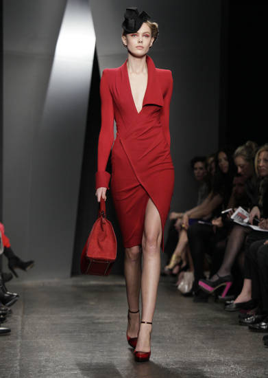 FILE - This Feb. 13, 2012 file photo shows an outfit from the Donna Karan Fall 2012 collection during Fashion Week in New York. Polished sophistication is the new trend after previous trends that have alternately favored bohemian, aggressive and blingy looks. (AP Photo/Richard Drew, file)