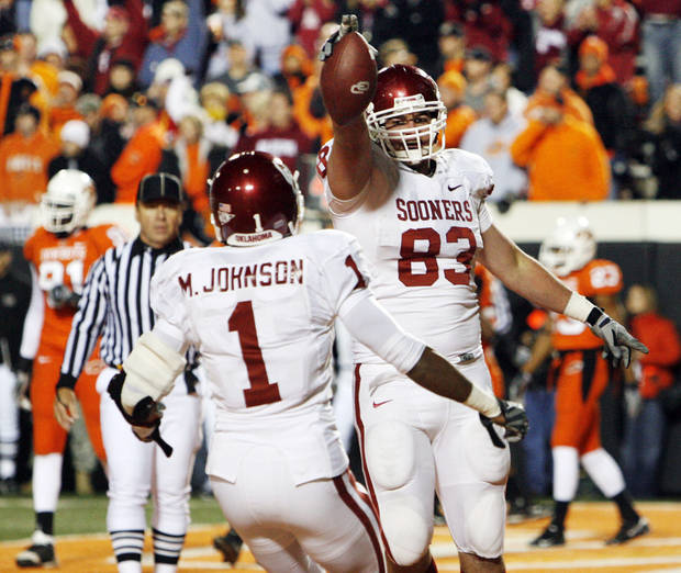 OU's Brody Eldridge (83) and Manuel Johnson (1) celebrate a touchdown catch by Eldridge during the second half of the college football game between the University of Oklahoma Sooners (OU) and Oklahoma State University Cowboys (OSU) at Boone Pickens Stadium on Saturday, Nov. 29, 2008, in Stillwater, Okla.    STAFF PHOTO BY NATE BILLINGS  ORG XMIT: KOD