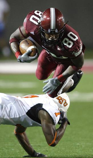 in first half action during the college football game between the Troy University Trojans and the Oklahoma State University Cowboys at Movie Gallery Veterans Stadium in Troy, Ala., Friday, September 14, 2007. BY STEVE SISNEY, THE OKLAHOMAN