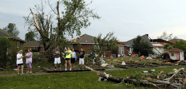 People look at debris along SW 149th between Western and Hudson after a tornado struck south Oklahoma City and Moore, Okla., Monday, May 20, 2013. Photo by Nate Billings, The Oklahoman