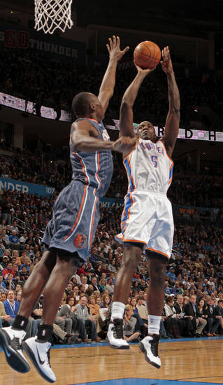 Oklahoma City Thunder's Kendrick Perkins (5) scores in the first period during the NBA basketball game between the Oklahoma City Thunder and the Charlotte Bobcats at Chesapeake Energy Arena in Oklahoma City, Saturday, March 10, 2012. Photo by Steve Sisney, The Oklahoman